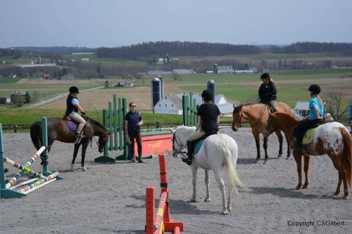 Melissa Hunsberger gives a lesson at Harvest View Stables.
